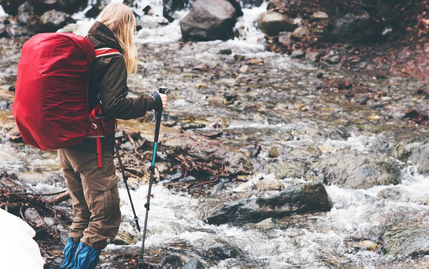 Woman walks through muddy path