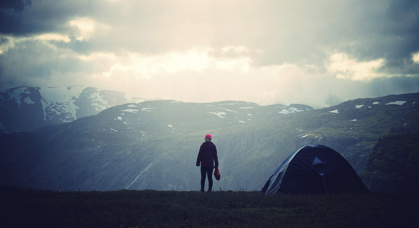 Hiker stands on a mountain